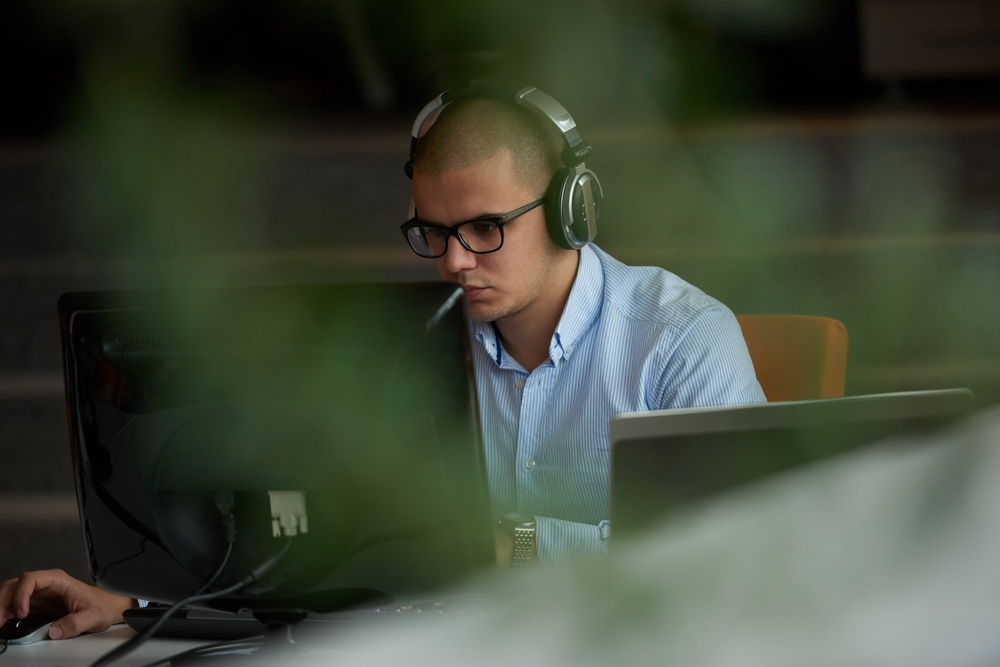 startup business, software developer working on computer at modern office.jpeg